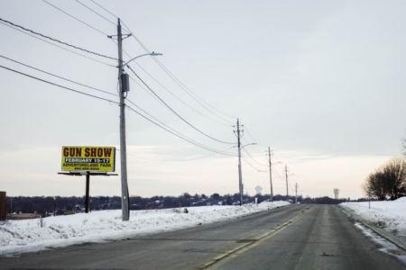 Reklam för vapenmässa i Iowa